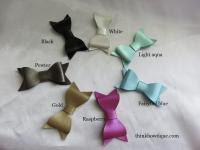 Faux metallic leather bows
